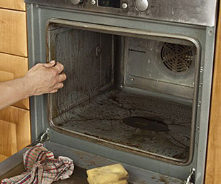 Direty Oven being Cleaned
